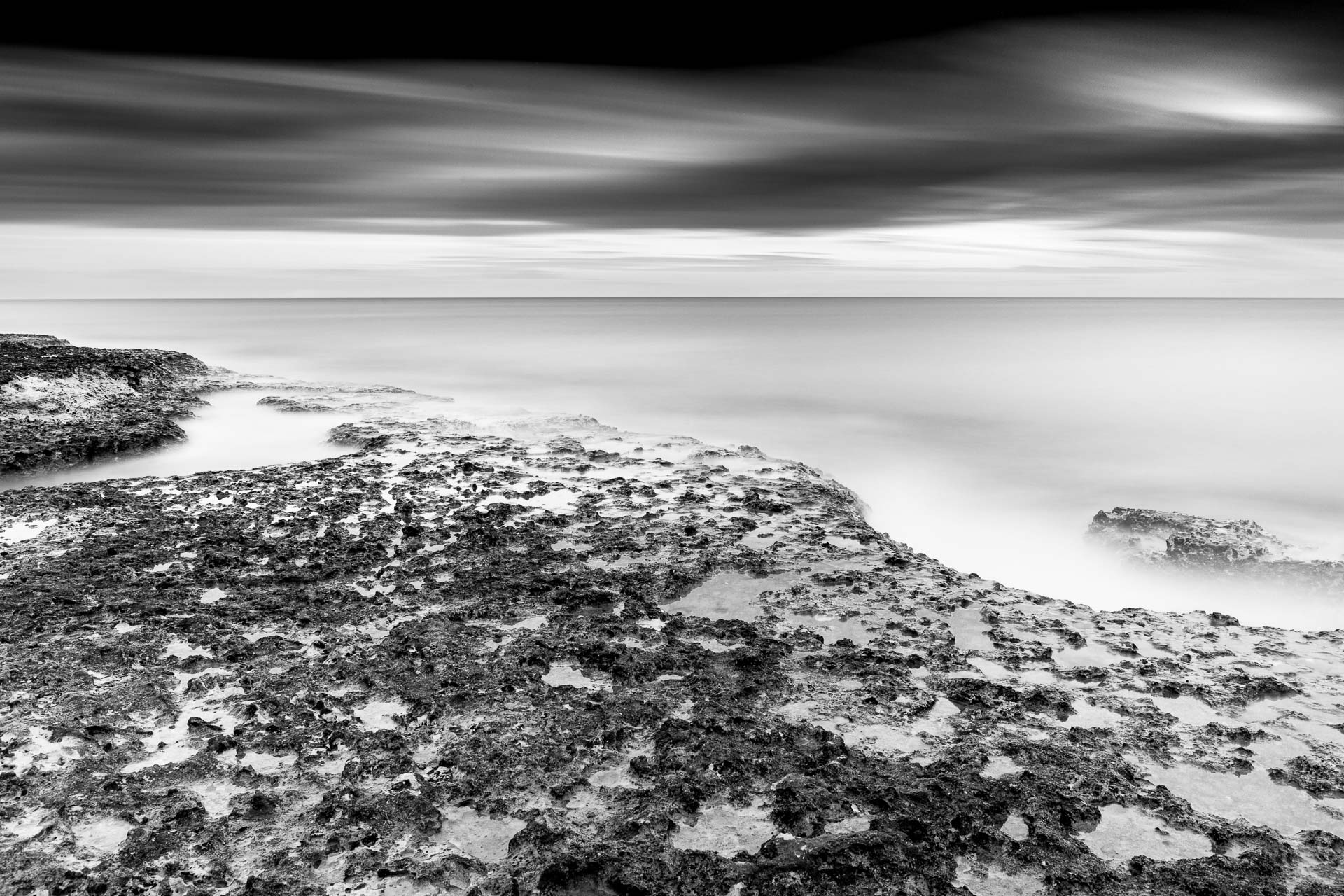 Seascape in sunset, black and white long exposure photography